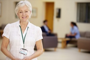Portrait Of Female Consultant In Hospital Reception
